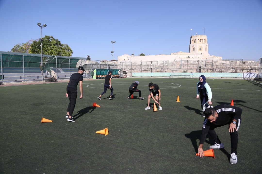 Al-Quds University resumes the practical educational course In the playgrounds of Burj Alluqluq Social Center Society
